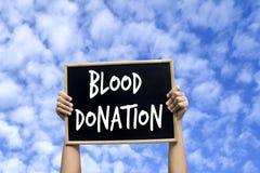 Ge första erfarenhet donation med bakgrund för blå himmel arkivbild
