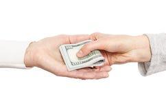 ge handpengar annan till royaltyfri bild