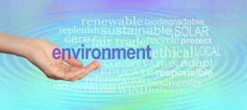 Ge vår miljö en portionhand royaltyfri bild