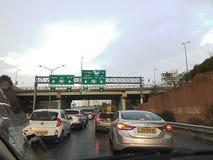 Geah高速公路,在多雨天气的早晨交通 现代的Junctiion 库存照片