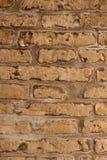 Gealterte braune Hintergrundwand der Ziegelsteine Stockbilder