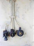 Gealterte elektrische Knöpfe - Vertikale Stockfoto