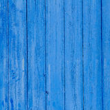 Gealterte grunge verwitterte blaue Türholzbeschaffenheit Stockfotografie
