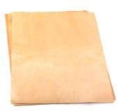 Gealterte Papierseiten auf Weiß Stockfotografie