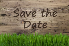 Gealterter hölzerner Hintergrund, Gras, Text-Abwehr das Datum Stockfotos