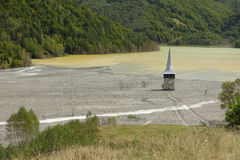 Geamana Church on polluted lake Royalty Free Stock Photography