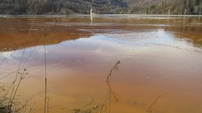 Geamana lake and flooded church near Rosia Montana, Romania stock video