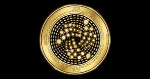 Geanimeerd cryptocurrency gouden muntstuk van Jota MIOTA stock footage