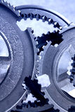 Gear. The interlocking gear wheels in bluish royalty free stock photography