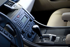 Gear and audio system in car. A closeup of the gearstick and audio system controls on the inside of a new car Stock Images