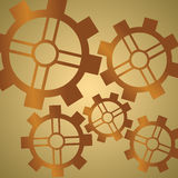 Gear Background Brass. Brass colored gears on a gradient tan background Royalty Free Stock Image