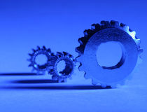 Gear on Blue. Three gears under blue gel Stock Photography