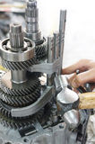 Gear Box. A pair of technician hand fixing the car gearbox Stock Photography
