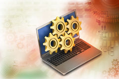 Gear cog with laptop Royalty Free Stock Images