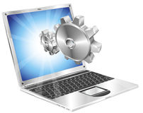 Gear cogs flying out of laptop screen concept Royalty Free Stock Photos