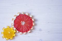 Gear drive made of citrus slices. On wooden background Royalty Free Stock Photos