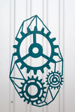 Gear hand drawn mechanism on gray wall Royalty Free Stock Photos