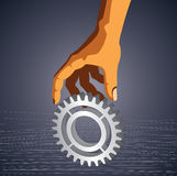 Gear in hand on gray background Stock Images