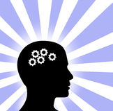 Gear Head Man Profile Thinking on blue white  Rays. Gear symbol in the head of a thinking silhouette man on a background of blue red rays Stock Photos