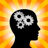 Gear Head Man Thinking on Gold Rays. Gear symbol in the head of a thinking silhouette man on a background of orange red rays royalty free illustration