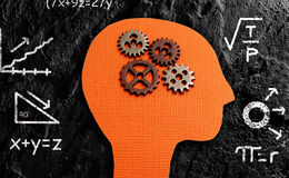 Gear head math. Gears and paper figure head with math formulas Stock Photo
