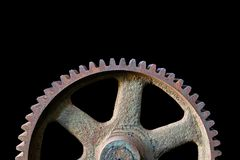 Gear industrial. Closeup of a large gear from an abandoned coal mine isolated over black Stock Image