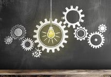Gear with interlocking cogwheels with glowing light bulb on blackboard. Teamwork concept vector illustration