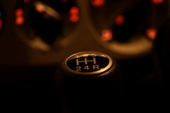 Gear knob. In a car in beautiful yellow light Stock Photo