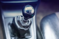 Gear knob in car. Purple toning royalty free stock images