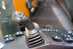 Gear lever and steering buttons. Tractor interior. Stock Photos