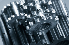 Gear machinery from above. Gear-mechanism and its reflection in a metallic blue cast against stainless-steel, assembly seen from above Royalty Free Stock Image