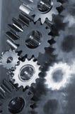 Gear machinery in metallic blue-idea. Five gears in action, in a metallic blue tone, mirrored in bluish titanium Royalty Free Stock Image