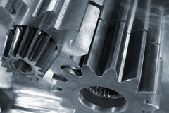 Gear machinery and steel Stock Images