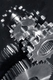Gear machinery in titanium. Industrial gears machinery in steel mirrored in titanium background and in a duplex silver toning idea Royalty Free Stock Photography