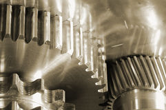 Gear-machinery, from underneath Royalty Free Stock Photos