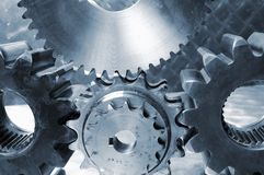 Gear mchinery in blue Stock Images