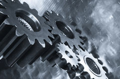Gear-mechanics in metallic blue toning. Gear mechanism against titanium in a duplex blue toning, industrial gears, powerful wide and tilted perspective Stock Photography