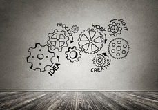 Gear mechanism as teamwork concept. Gear hand drawn mechanism on gray wall Stock Photography