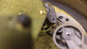 Gear mechanism of the old clock close-up. Concept of clockwork,. Gear mechanism of the old clock close-up. Concept of industrial, science, clockwork, technology stock video