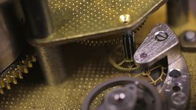 Gear mechanism of the old clock close-up. Concept of clockwork,. Gear mechanism of the old clock close-up. Concept of industrial, science, clockwork, technology stock footage