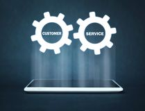 Gear mechanism on tablet screen. Customer Service Concept stock image