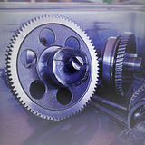 Gear metal wheels close-up. Gears and cogs macro blue toned Royalty Free Stock Photo
