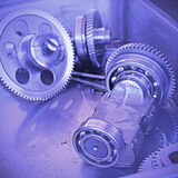 Gear metal wheels close-up. Gears and cogs macro blue toned Stock Photos