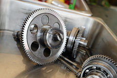 Gear metal wheels close-up. Gears and cogs macro Stock Image