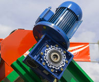 Gear motor close-up. Part of an agricultural machine close-up of a motor on a sky background Royalty Free Stock Photos