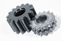 Gear parts ideal for cut-outs. Two industrial gears against white background, ideal for cut-outs stock photography