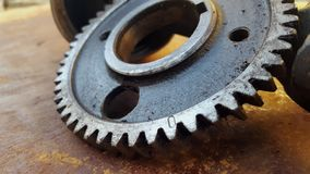 Gear rotary parts, the main driving component on the engine. In the machine block royalty free stock photo