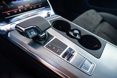 Gear shift in the car. Gear shift in new luxurious car royalty free stock image