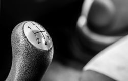Gear shift knob close up in a new car. Shallow depth of field, copy space in black and white stock image