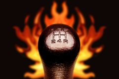 Gear stick 2. Gear stick with burning background Royalty Free Stock Image